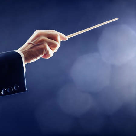 maestro: Music conductor hands orchestra conducting Stock Photo