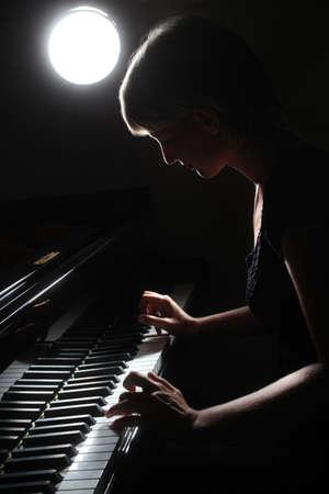 Piano classical music musician player  Pianist with grand piano musical instrument Foto de archivo