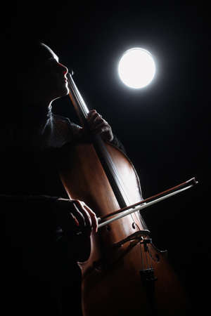 Cello classical music cellist player  Cellist with musical instrument in darkness