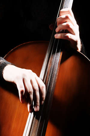 cellist: Cello playing cellist hands details musical instruments Stock Photo