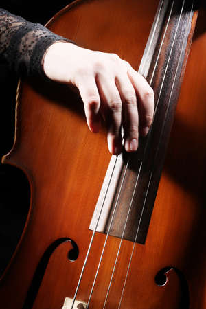 Cello playing cellist hand closeup orchestra instruments photo