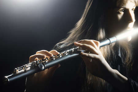 Flute music instrument flutist playing  Classical orchestra musician Stock Photo