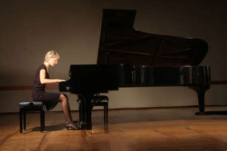 Grand piano pianist playing concert photo