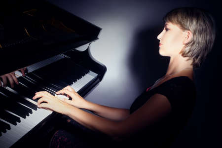 Piano playing pianist player  Woman with classical musical instrument grand piano