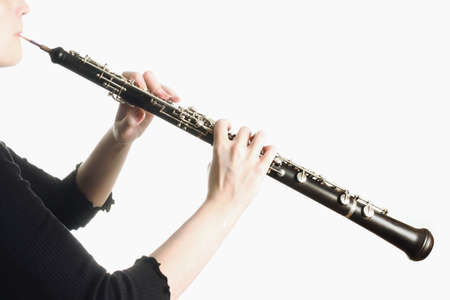 oboe: Musical instruments - oboe details with player hands Stock Photo