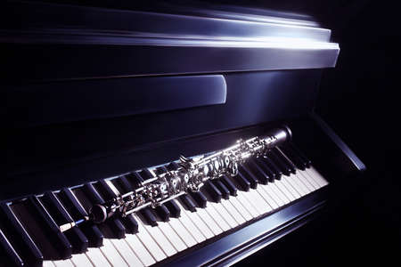 oboe: Musical instruments piano and oboe  Classical music orchestra instrument Stock Photo