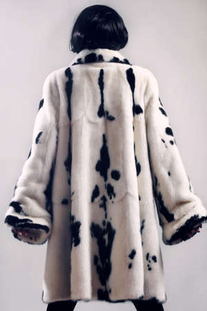 Fur coat winter clothes fashion  Woman in white mink spotty fur-coat photo