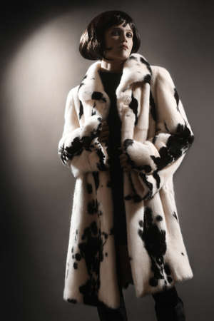 greatcoat: Fur coat winter clothes fashion  Woman in white mink spotty fur-coat Stock Photo