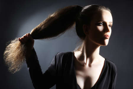 horsetail: Woman hairstyle with long hair ponytail  Young elegant model Stock Photo