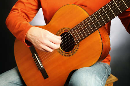 classical guitar: Acoustic guitar playing classical guitarist hands close up