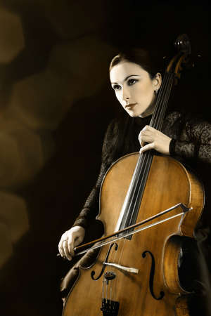 Cello orchestra player  Cellist musical instruments playing  photo