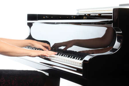 Piano hands pianist playing  Musical instruments details with player hand closeup photo