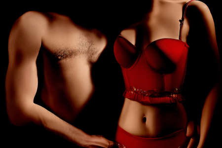 Nude sexy couple in darkness  Erotic Woman in red lingerie Stock Photo