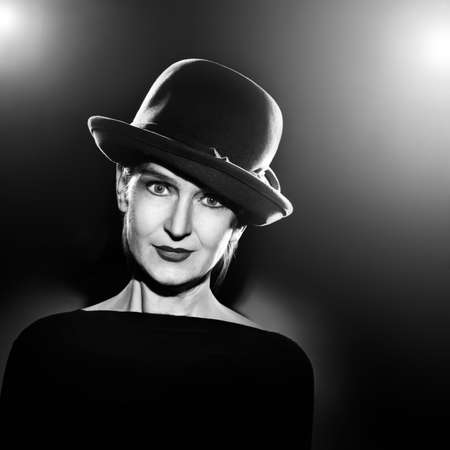 50 to 60: Woman in elegant hat Black and white portrait  Monochrome fine art photo Stock Photo