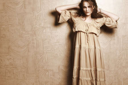 bell bottomed: Woman in beige vintage dress  Young romantic model retro portrait