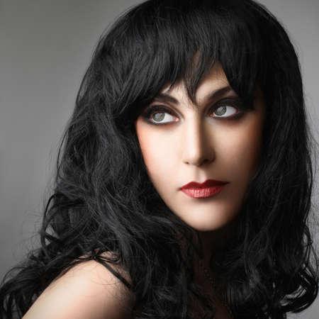 black hair: Brunette model black hair style woman portrait face with makeup