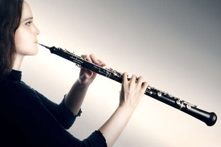 oboe: Oboe classical orchestra musician  Oboist music instrument playing