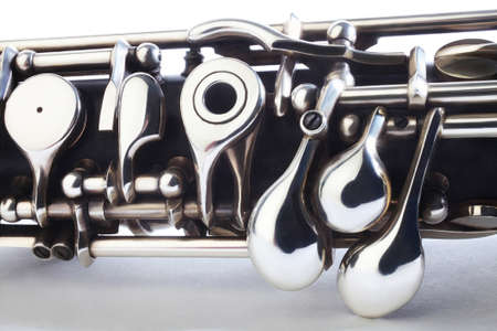 Oboe - musical instruments of symphony orchestra  Oboe mechanism detail closeup on white photo