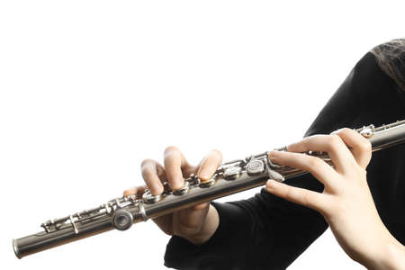 Flute music instrument hands close up flutist with musical instruments isolated on white Standard-Bild
