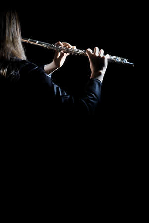 Flute player with music instrument Flutist playing concert