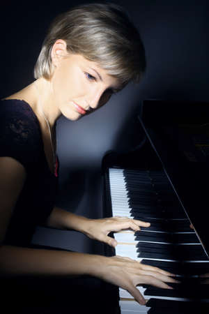 Piano playing pianist player  Woman with classical musical instrument photo