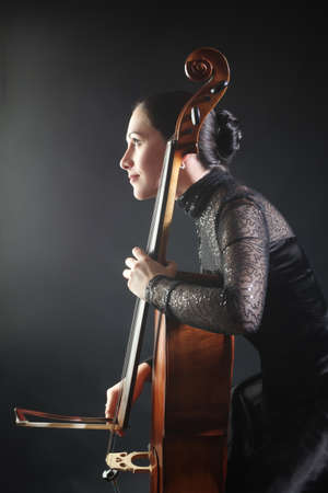 Cello player Cellist playing musical instruments orchestra classical musician photo
