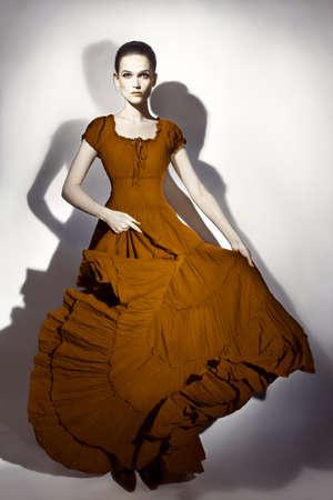 maxi dress: Fashion model in long dress  Elegant woman in maxi flying dress Stock Photo