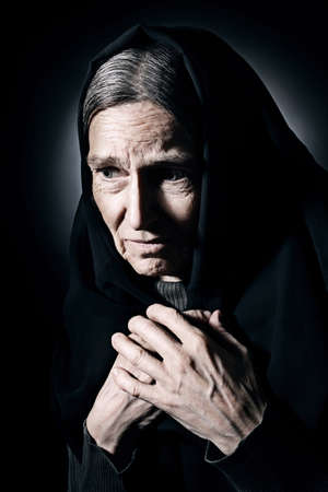 60 years old: Sad old woman Senior woman in sorrow depressed portrait with wrinkled face