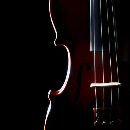 stringed: Violin orchestra musical instruments closeup isolated on black Stock Photo