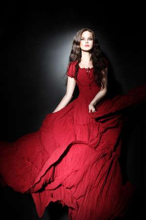 girl in burgundy dress: Elegant woman in red dress  Fashion model in long dress