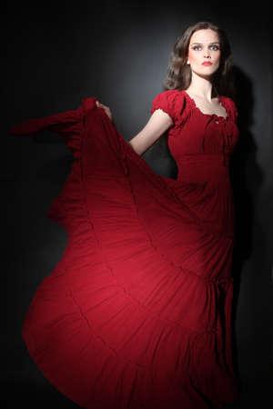maxi dress: Elegant woman in red dress  Fashion model in long dress  Flamenco dancer