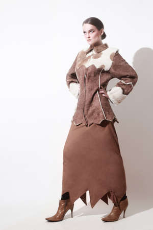 greatcoat: Winter clothes fashion model in long skirt and Sheepskin coat Stock Photo