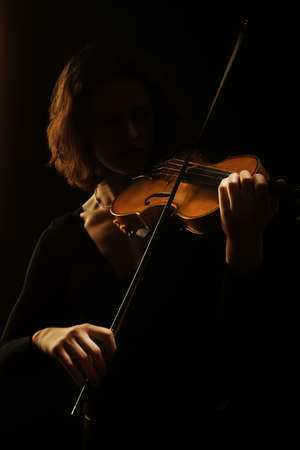 Violin player violinist. Orchestra musical instruments concert 스톡 콘텐츠