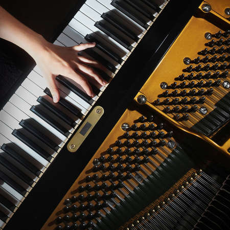 Grand piano closeup pianist hands playing Stock Photo