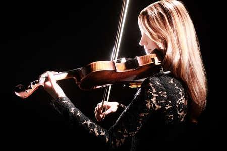 Violin player violinist Musical instruments of orchestra classical musician Foto de archivo