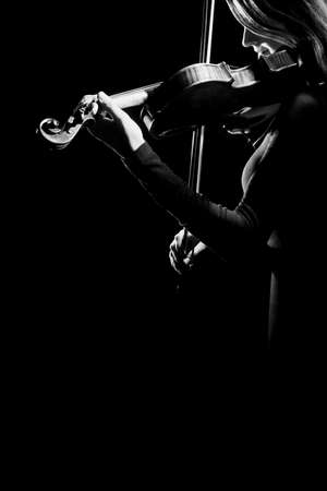 Violin player violinist Musical instruments of orchestra isolated on black photo