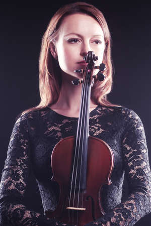 Beautiful woman portrait with violin Player violinist photo