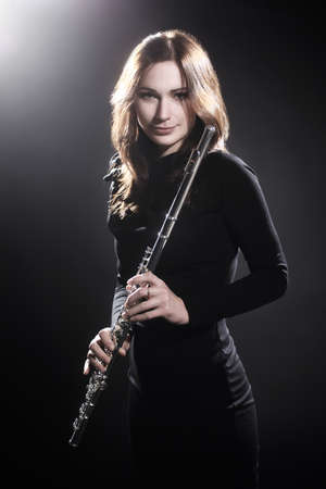 Woman with flute beautiful portrait of music performer