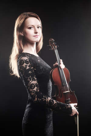 Portrait of beautiful woman with violin Player violinist photo