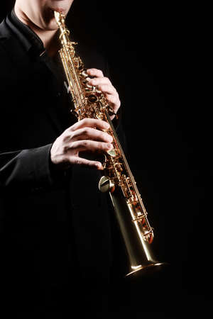 saxophonist: Saxophone soprano musical instruments with saxophonist hands closeup isolated on black