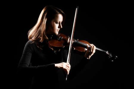violinista: Jugador del viol�n violinista tocando m�sica cl�sica. Instrumentos musicales Orquesta Foto de archivo