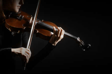 violin background: Violin player violinist hands closeup musical instruments