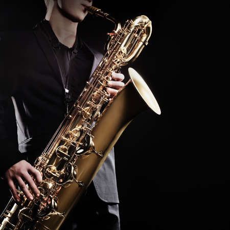 Saxophone baritone Saxophonist with sax jazz music instruments