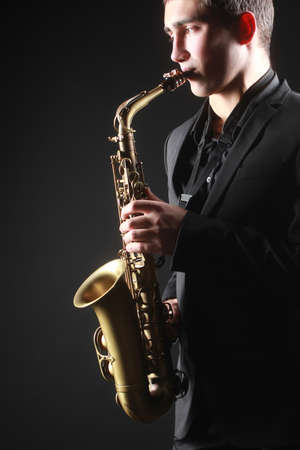 Saxophone player Saxophonist with sax alto man playing jazz music Stock Photo