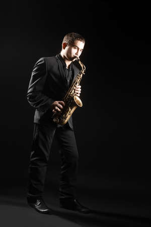 alto: Saxophone player Saxophonist with sax alto man playing jazz music Stock Photo