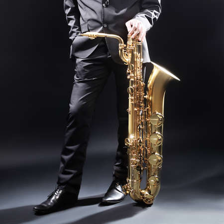 jazz music: Jazz man with Saxophone Player Saxophonist with sax baritone