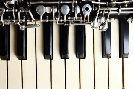 oboe: Musical instruments piano and oboe music instrument close up Stock Photo