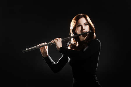 Flute player flutist classical musician playing music instrument