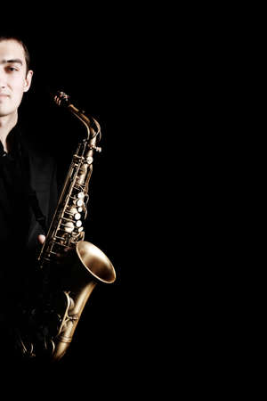 Saxophone player Saxophonist with sax alto closeup isolated on black