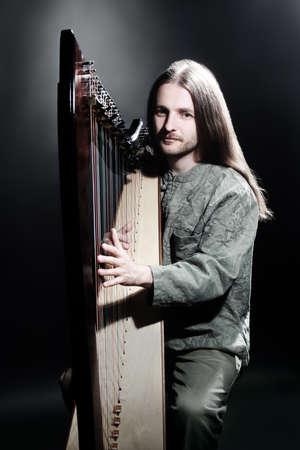 Irish harp player. Musician harpist music performer portrait Stock Photo